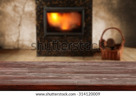 blurred background of fireplace and board of retro wood and free space