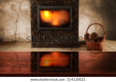 blurred background of fireplace and dark deck top