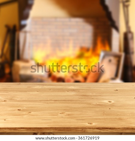 blurred background of fireplace and deck of wood and free place  - stock photo