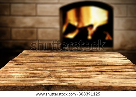 blurred background of fireplace and shabby table of wood  - stock photo