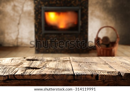 blurred background of fireplace and wooden shelf
