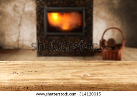 blurred background of fireplace and xmas table  - stock photo