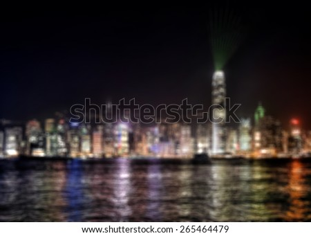 Blurred background of Hong Kong harbor and night skyline at symphony of lights night show