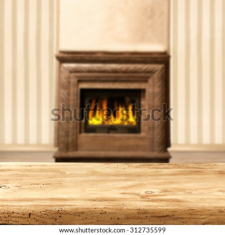 blurred background of interior with fireplace and desk board