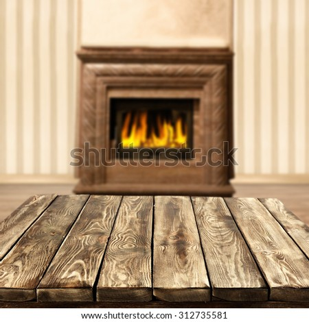 blurred background of interior with fireplace and worn old table