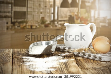 blurred background of kitchen and morning time flour and eggs and free space
