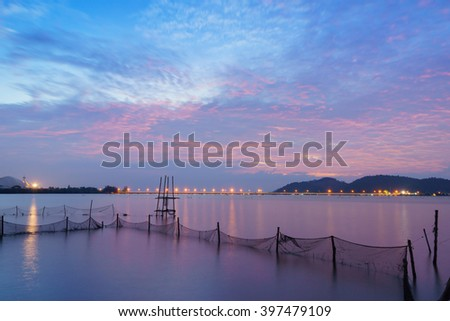 Blurred background of Lake sky island bridge and lighting flare lens on night view:Unfocused image:Ideal use for background.