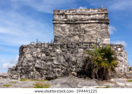 Blurred background of Mayan ruins at the archeological site of Tulum, Quintana Roo, Mexico. - stock photo