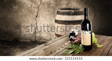 blurred background of old barrel and fresh fruits and wine  - stock photo