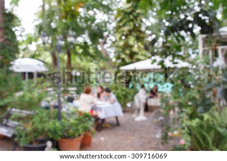 Blurred background of people activities in restaurant with bokeh