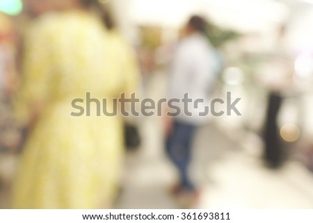 Blurred background of people walking. Unrecognizable faces - stock photo