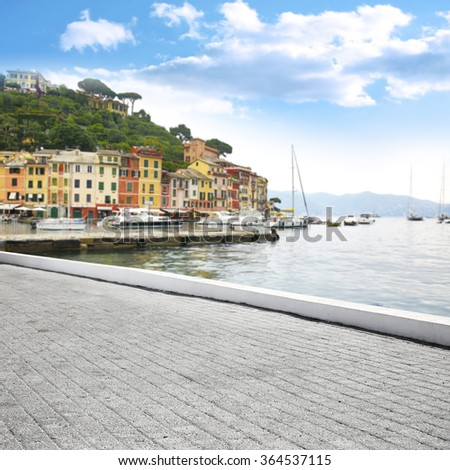 blurred background of Portofino port and gray street  - stock photo