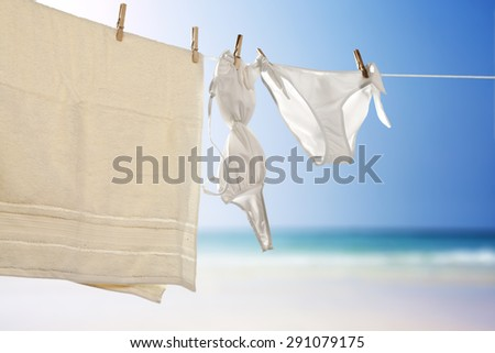 blurred background of sea and towel with swimsuit