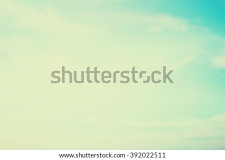 blurred background of sky and clouds.blurry natural backdrop concept.pastel cool tone color.colorful of blue teal gradient image:brightening sunshine day on summer season:vintage tone filter effect - stock photo