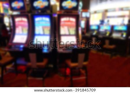 blurred background of slot machines in casino          - stock photo
