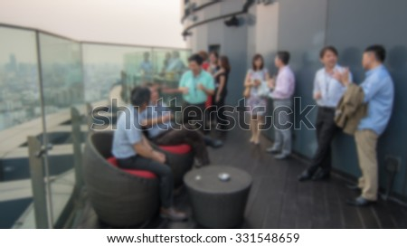 blurred background of talking people