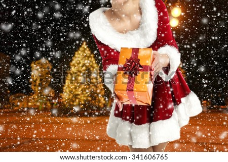 blurred background of winter night and big gift  - stock photo