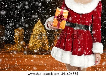 blurred background of winter night and snowflakes and gift  - stock photo