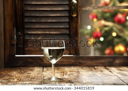 blurred background of xmas tree lights and window of champagne and wooden old sill and space for you  - stock photo