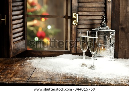 blurred background of xmas tree lights and window of free place for your decoration  - stock photo