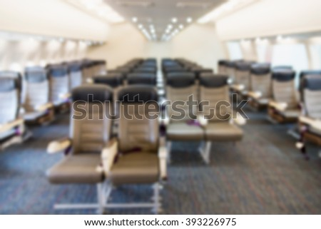 Blurred background passenger seat of plane. - stock photo