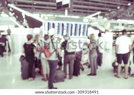 blurred background : passengers waiting and looking at time schedule at the airport terminal -  blur background concept - stock photo