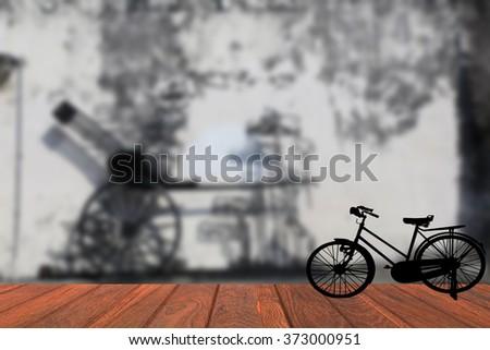 Blurred background Penang  landmark silhouette old bike - stock photo
