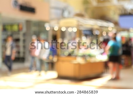 Blurred background : people shopping at mall in sunny day, blur background with bokeh - stock photo