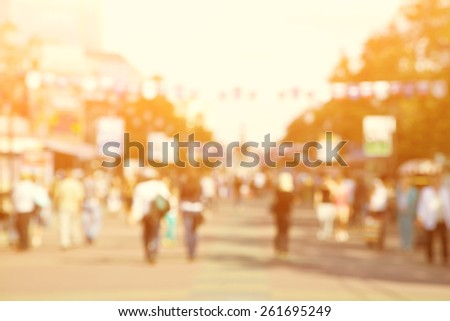 blurred background. people walking on a city street - stock photo