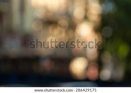 Blurred background photo.Cityscape bokeh. Defocused abstract city.Background out of focus.Can use as wallpaper, design. Summer blurry city backdrop.Travel out of focus photos. Fairy defocused photos.  - stock photo