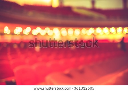Blurred background, Red seat row in theatre with vintage filter - stock photo