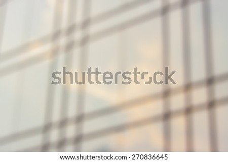 Blurred background reflections of clouds and blue sky  - stock photo
