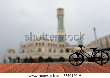Blurred background sights  Penang  silhouette old bike:Penang Malaysian background blur motocycle old wooden mosque - stock photo