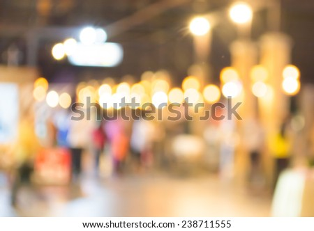 blurred background. street decorated with festive lights. - stock photo