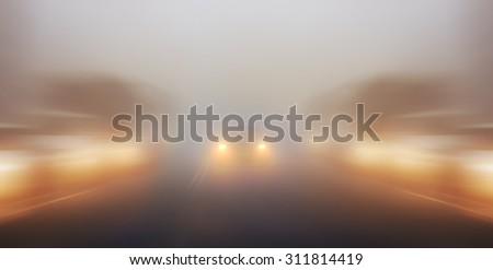 blurred background traffic jams foggy night - stock photo