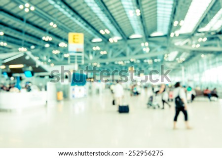 Blurred background : Traveler at airport terminal blur background with bokeh light,Vintage filter - stock photo