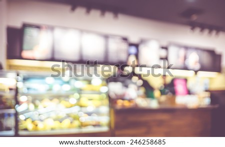 Blurred background : Vintage filter ,Barista at Coffee shop counter service blur background with bokeh - stock photo