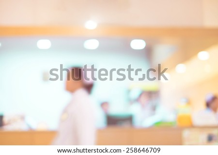Blurred background : Vintage filter nurse at hospital counter. - stock photo