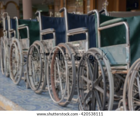 blurred background Wheelchair for hospital patients, Wheelchairs for the Disabled, wheelchair access, Wheelchair Hospital, Equipment Facilities,row, Wheelchair parked in a row, Transporting patient  - stock photo