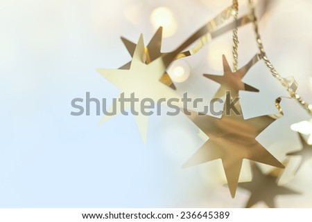 Blurred background with bokeh and garland of stars - stock photo