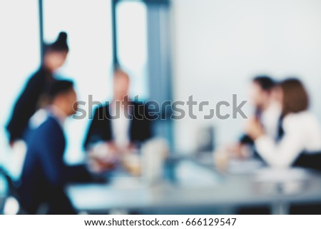 Blurred background with business people