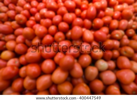 Blurred background with fresh tomato, closeup