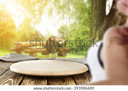 blurred background with young woman and free space and wooden space  - stock photo