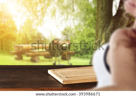 blurred background with young woman and red desk  - stock photo