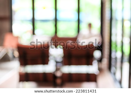 Blurred background : Woman reading newpaper in garden of Coffee shop with bokeh - stock photo