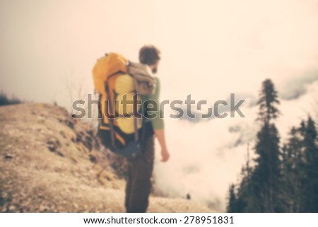 Blurred Background Young Man Traveler with backpack relaxing outdoor Lifestyle hiking concept trendy style - stock photo