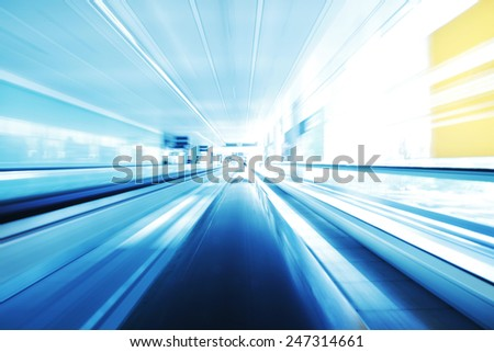 Blurred backround of moving futuristic escalator - stock photo