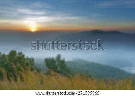 Blurred  beautiful epic sunrise on mountain background. Abstract  backdrop. Nature background. Landscape background. . Bright colors  wallpaper - stock photo