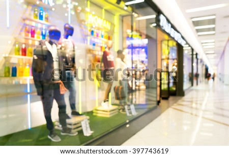 Blurred beautiful lobby at the malls. Blurred showcases fashion boutique with clothes. Blurred bokeh basic background for design. - stock photo