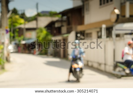 Blurred bike on road in Chiangmai Thailand - stock photo